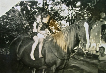 Anna Hardy on horseback with unknown child and John Bailey on the right