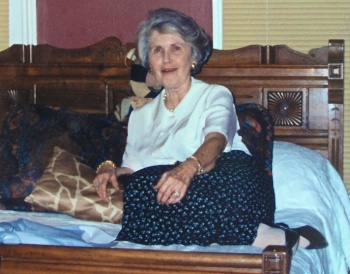 Betty Billups trying out the remodeled bedroom at Allen and Mary Anne's House, Blythewood.