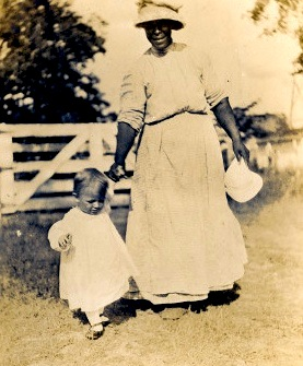 Carleton with caregiver circa 1913