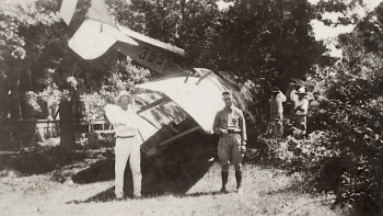 Collier Hardy, in white, in his yard after WW1 Jenny crashed in 1918. Legend has it that the pilot was buzzing the house to get the attention of Rebekah.