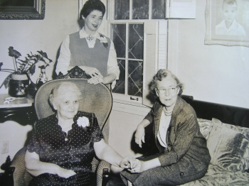 Lenore Hardy Billups seated on couch at home of Rufus and Ida Ward.