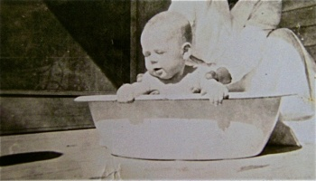Infant in tiny tub
