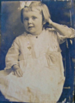 portrait of unknown child with hair bow