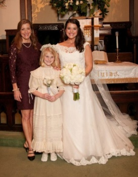 Sarah Frances Hardy, with her daughter Julia, the flower girl at Caroline Webb Clark's wedding 2012