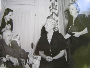 Seated in the middle is Aunt Genie, in the chair is B Willie Evans, and behind her is Mary Ita Hardy